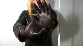 emily-putting-on-tight-girls-leather-gloves