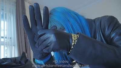 girl-putting-on-leather-gloves-black-leather-jacket