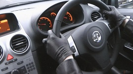 girl-wearing-leather-driving-gloves-in-manual-car