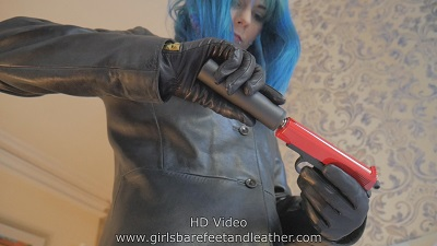 girl-with-gun-leather-gloves-jacket-pants-boots