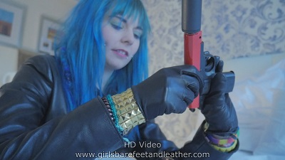 girl-with-silencer-leather-gloves-leather-jacket
